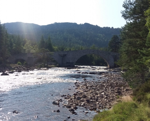 a Scottish salmon fishing river in mid summer on a sunny day with low water levels